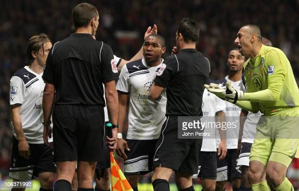 Wilson Palacios and Heurelho Gomes of Tottenham Hotspur complain to assistant referee Simon Beck and referee Mark Clattenburg over Nani's goal for...