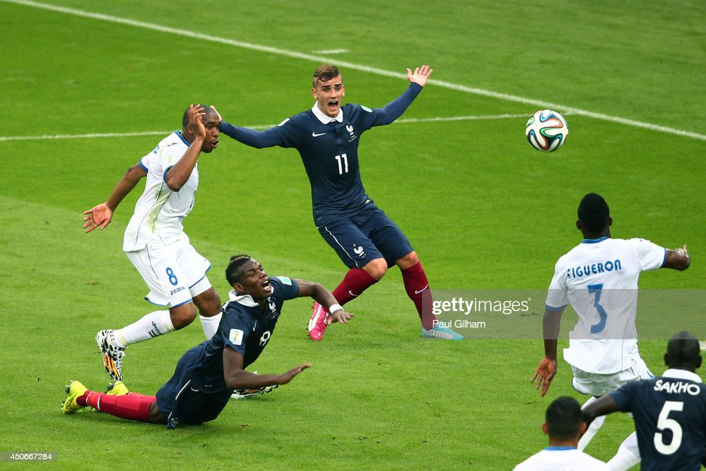 Wilson Palacios of Honduras fouls Paul Pogba of France resulting in a penalty kick as Antoine Griezmann reacts during the 2014 FIFA World Cup Brazil Group E match between France and Honduras at Estadio Beira-Rio on June 15, 2014 in Porto Alegre, Brazil.