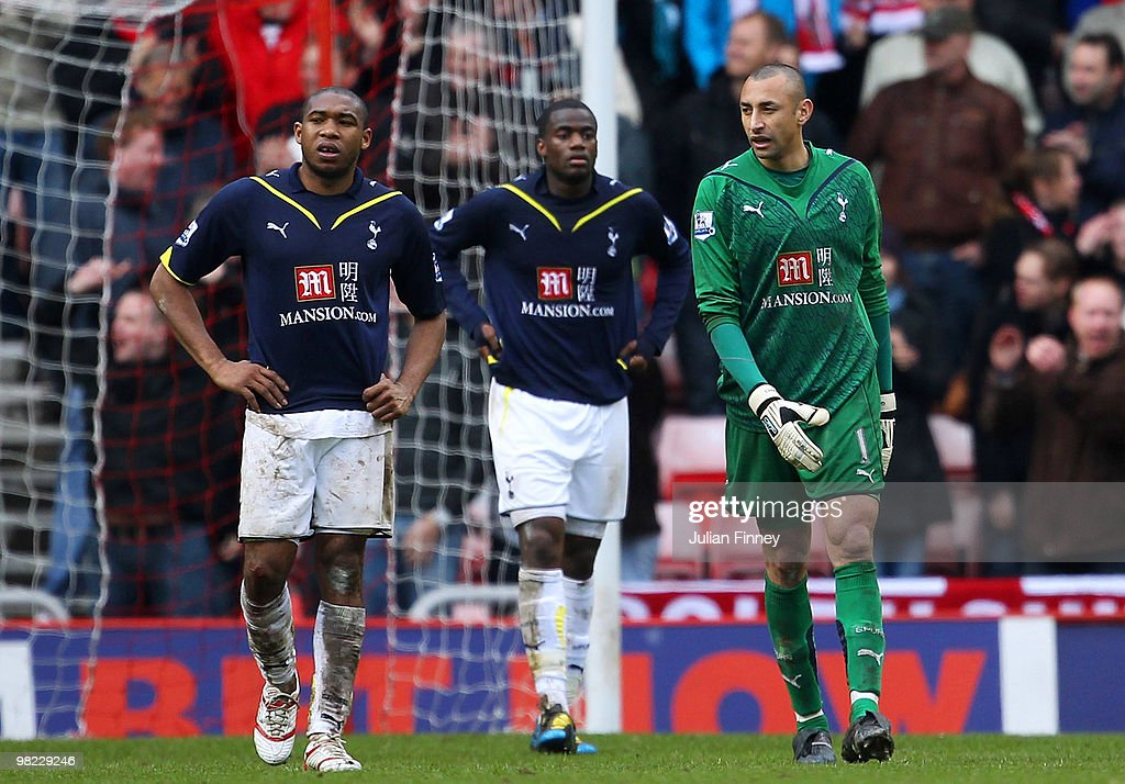 Wilson Palacios Sebastien Bassong and Heurelho Gomes look dejected after conceding the third goal during the Barclays Premier League match between...