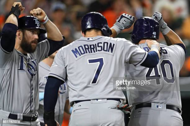 Wilson Ramos of the Tampa Bay Rays celebrates with teammates after hitting a grand slam home run during the second inning against the Baltimore...