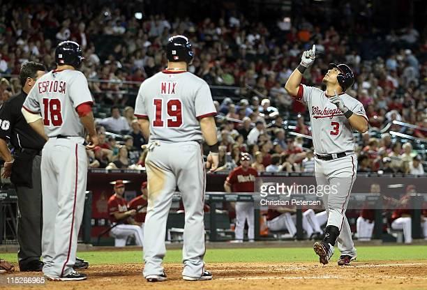 Wilson Ramos of the Washington Nationals celebrates with Laynce Nix and Danny Espinosa after hitting a threerun home run against the Arizona...