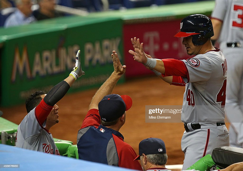 Wilson Ramos #40 of the Washington Nationals is congratulated after scoring during a game against the Miami Marlins at Marlins Park on September 18, 2014 in Miami, Florida.
