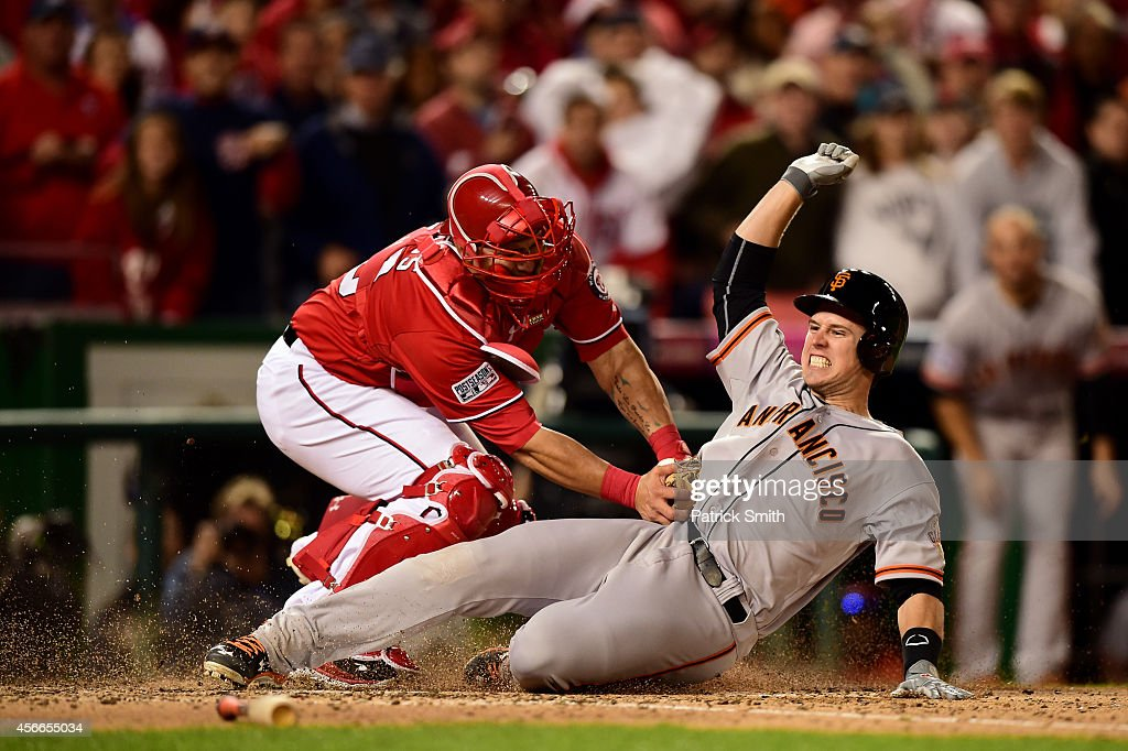 <a gi-track='captionPersonalityLinkClicked' href=/galleries/search?phrase=Wilson+Ramos&family=editorial&specificpeople=4866956 ng-click='$event.stopPropagation()'>Wilson Ramos</a> #40 of the Washington Nationals tags out <a gi-track='captionPersonalityLinkClicked' href=/galleries/search?phrase=Buster+Posey&family=editorial&specificpeople=4896435 ng-click='$event.stopPropagation()'>Buster Posey</a> #28 of the San Francisco Giants at home plate after Pablo Sandoval #48 of the San Francisco Giants hit a double to left field in the ninth inning during Game Two of the National League Division Series at Nationals Park on October 4, 2014 in Washington, DC.