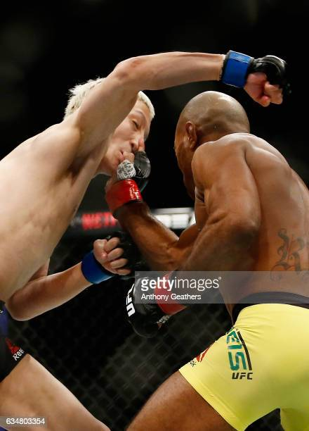 Wilson Reis of Brazil defends himself against Ulka Sasaki of Japan in their flyweight bout during UFC 208 at the Barclays Center on February 11 2017...