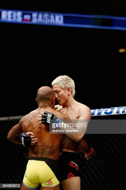 Wilson Reis of Brazil embraces Ulka Sasaki of Japan after their flyweight bout during UFC 208 at the Barclays Center on February 11 2017 in the...