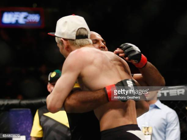 Wilson Reis of Brazil embraces Ulka Sasaki of Japan after winning by unanimous decision in their flyweight bout during UFC 208 at the Barclays Center...