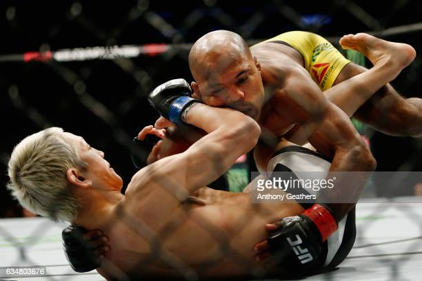 Wilson Reis of Brazil fights against Ulka Sasaki of Japan in their flyweight bout during UFC 208 at the Barclays Center on February 11 2017 in the...
