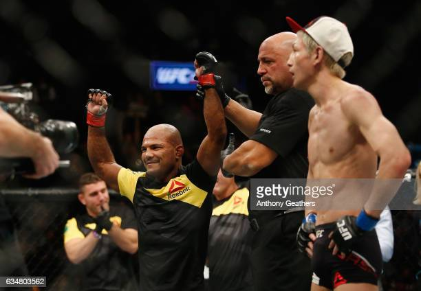 Wilson Reis of Brazil is announced winner by unanimous decision against Ulka Sasaki of Japan after their flyweight bout during UFC 208 at the...