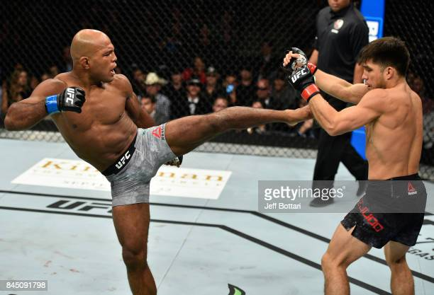 Wilson Reis of Brazil kicks Henry Cejudo in their flyweight bout during the UFC 215 event inside the Rogers Place on September 9 2017 in Edmonton...
