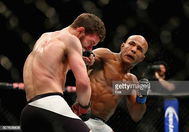 Wilson Reis of Brazil lands a right punch against Dustin Ortiz of the United States in their flyweight bout during the UFC Fight Night event at the...