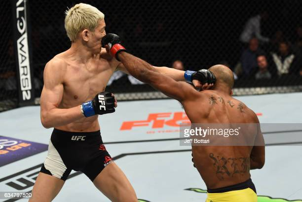 Wilson Reis of Brazil punches Ulka Sasaki of Japan in their flyweight bout during the UFC 208 event inside Barclays Center on February 11 2017 in...