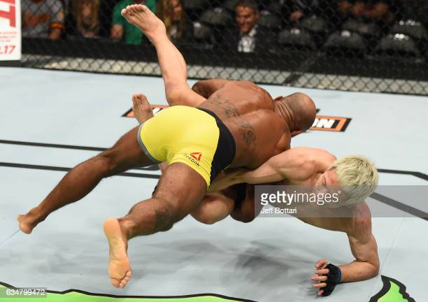 Wilson Reis of Brazil takes down Ulka Sasaki of Japan in their flyweight bout during the UFC 208 event inside Barclays Center on February 11 2017 in...