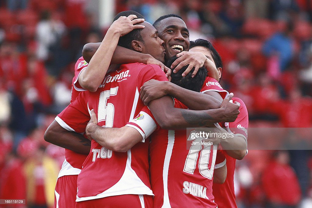 Wilson Tiago (R) and Luis Tejada (L)of Toluca celebrates score a goal against Tijuana during a match Clausura 2013 Liga MX at Nemesio Diez Stadium on march 30, 2012 in Toluca, Mexico.