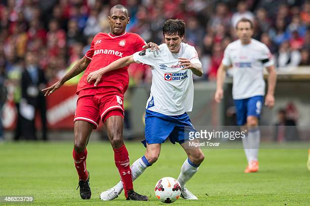 Wilson Tiago Mathias of Toluca fights for the ball with Mauro Formica of Cruz Azul during the leg 2 of the final match between Cruz Azul and Toluca...