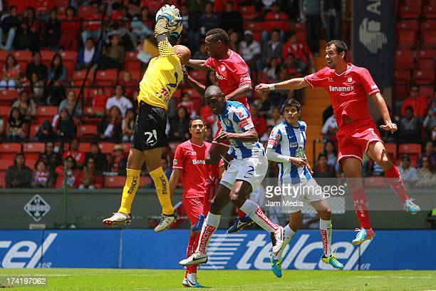 Wilson Tiago of Toluca struggles for the ball with Oscar Perez of Tijuana during the match between Toluca and Pachuca as part of the Apertura 2013...
