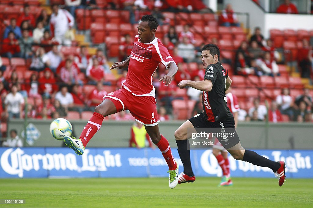 Wilson Tiago (L) of Toluca struggles for the ball with Pablo Aguilar (R) of Tijuana during a match Clausura 2013 Liga MX at Nemesio Diez Stadium on march 30, 2012 in Toluca, Mexico.