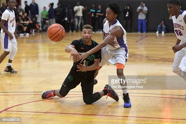 Wilson Tigers guard Ayinde Hikim passes to keep the ball in possession as Theodore Roosevelt Rough Riders guard Derrick Brown comes on in the first...