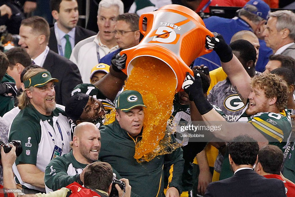 C.J. Wilson #98, T.J. Lang #70 and <a gi-track='captionPersonalityLinkClicked' href=/galleries/search?phrase=Ryan+Pickett&family=editorial&specificpeople=2121545 ng-click='$event.stopPropagation()'>Ryan Pickett</a> #79 of the Green Bay Packers dump Gatorade on head coach <a gi-track='captionPersonalityLinkClicked' href=/galleries/search?phrase=Mike+McCarthy+-+American+Football+Coach&family=editorial&specificpeople=639233 ng-click='$event.stopPropagation()'>Mike McCarthy</a> after they defeated the Pittsburgh Steelers 31 to 25 in Super Bowl XLV at Cowboys Stadium on February 6, 2011 in Arlington, Texas.