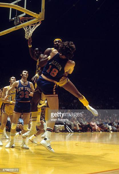 Wilt Chamberlain of the Los Angeles Lakers and Phil Jackson of the New York Knicks fight for the ball circa 1972 at the Forum in Inglewood California...