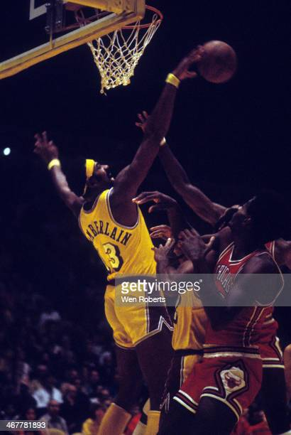Wilt Chamberlain of the Los Angeles Lakers blocks a shot attempt during an NBA game against the Chicago Bulls during the 19711972 season at the Forum...