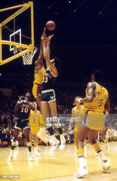 Wilt Chamberlain of the Los Angeles Lakers blocks a shot attempt by Kareem AbdulJabbar of the Milwaukee Bucks during the 19711972 season at the Forum...