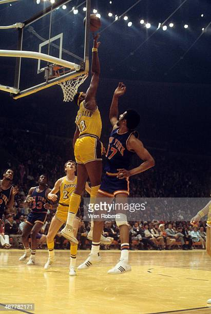 Wilt Chamberlain of the Los Angeles Lakers blocks the shot attempt by Nate Bowman of the New York Knicks during the 19691970 season at the Forum in...