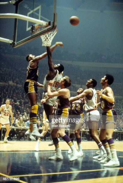 Wilt Chamberlain of the Los Angeles Lakers blocks the shot by Willis Reed of the New York Knicks as Jerry West Elgin Baylor and Dick Garrett of the...