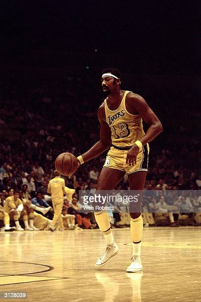 Wilt Chamberlain of the Los Angeles Lakers dribble drives circa 1970 during the NBA game at the Forum in Los Angeles California NOTE TO USER User...
