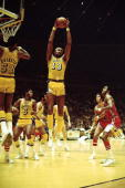 Wilt Chamberlain of the Los Angeles Lakers grabs a rebound against the the Philadelphia 76ers in Los Angeles CA 1973 NOTE TO USER User expressly...