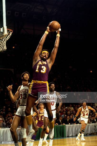 Wilt Chamberlain of the Los Angeles Lakers grabs the rebound against Kareem AbdulJabbar of the Milwaukee Bucks circa 1972 at the Bradley Center in...