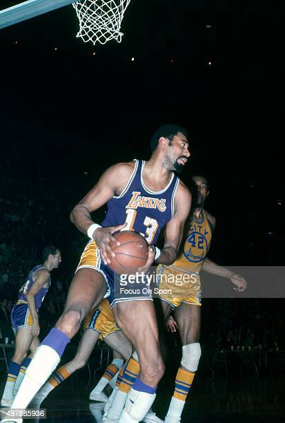 Wilt Chamberlain of the Los Angeles Lakers in action against the Golden State Warriors during an NBA basketball game circa 1971 at the OaklandAlameda...