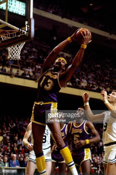 Wilt Chamberlain of the Los Angeles Lakers rebounds during a game against the Boston Celtics played on February 7 1973 at Boston Garden in Boston...