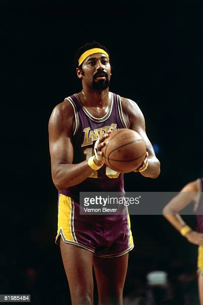 Wilt Chamberlain of the Los Angeles Lakers shoots a free throw against the Milwaukee Bucks during the 1970 season at the MECCA Arena in Milwaukee...