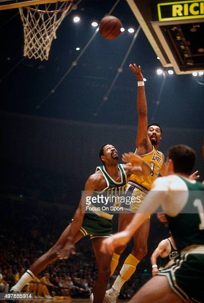 Wilt Chamberlain of the Los Angeles Lakers shoots over Bill Russell of the Boston Celtics during an NBA basketball game circa 1968 at The Forum in...