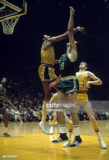 Wilt Chamberlain of the Los Angeles Lakers tries to block the shot attempt by Dave Cowens of the Boston Celtics during the 19711972 season at the...