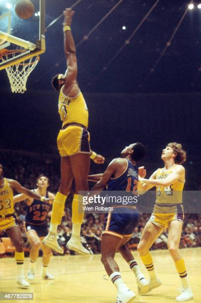 Wilt Chamberlain of the Los Angeles Lakers tries to block the shot attempt by Dick Barnett of the New York Knicks during the 19711972 season at the...