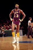 Wilt Chamberlain of the Los Angeles Lakers walks the court during a game played against Milwaukee Bucks in 1972 at the Mecca in Milwaukee Wisconsin...