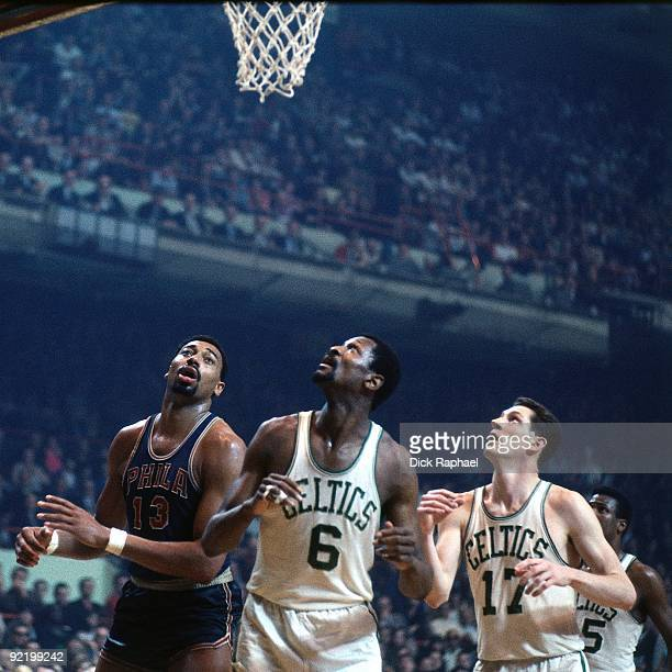 Wilt Chamberlain of the Philadelphia 76ers battles for the rebound against Bill Russell and John Havlicek of the Boston Celtics during a game played...