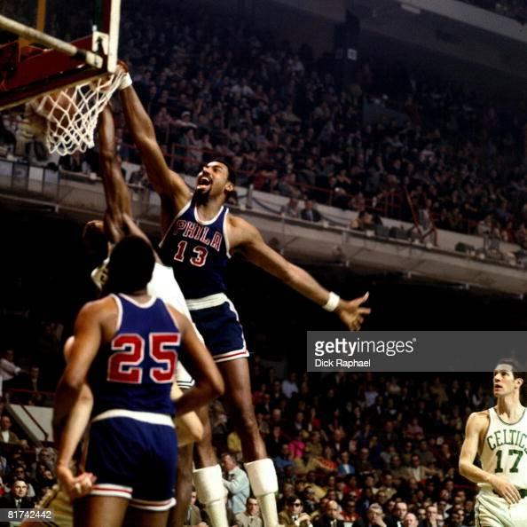 Wilt Chamberlain of the Philadelphia 76ers dunks against the Boston Celtics during a game played in 1967 at the Boston Garden in Boston Massachusetts...