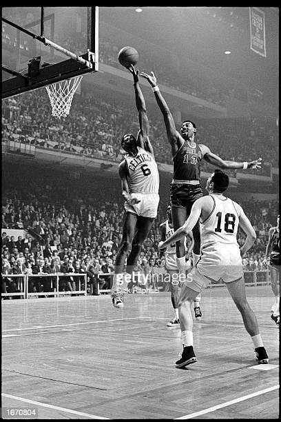 Wilt Chamberlain of the Philadelphia 76ers gets his shot blocked by Bill Russell of the Boston Celtics during the 1960 NBA game at the Boston Garden...