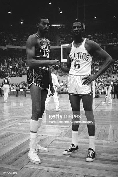 Wilt Chamberlain of the Philadelphia 76ers shakes hands with Bill Russell of the Boston Celtics at Boston Garden on November 16 1959 in Boston...