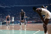 Wilt Chamberlain of the Philadelphia 76ers shoots a free throw against the Boston Celtics during a game played in 1968 at the Boston Garden in Boston...