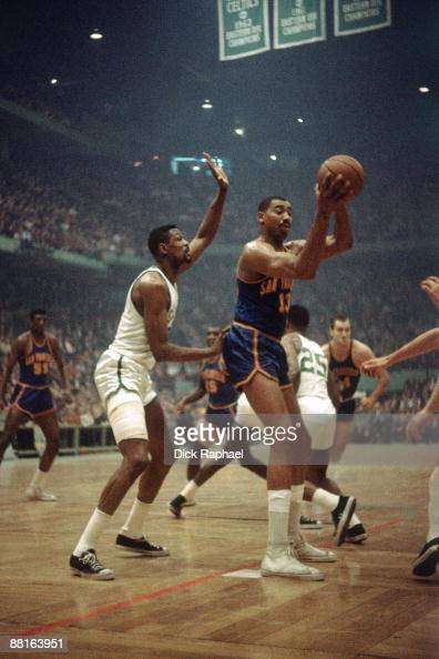 Wilt Chamberlain of the San Francisco Warriors posts up against Bill Russell of the Boston Celtics during a game played in 1964 at the Boston Garden...