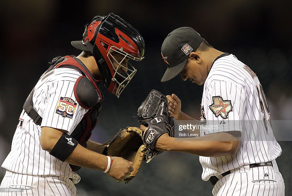 <a gi-track='captionPersonalityLinkClicked' href=/galleries/search?phrase=Wilton+Lopez&family=editorial&specificpeople=4901786 ng-click='$event.stopPropagation()'>Wilton Lopez</a> #59 of the Houston Astros and <a gi-track='captionPersonalityLinkClicked' href=/galleries/search?phrase=Carlos+Corporan&family=editorial&specificpeople=5716887 ng-click='$event.stopPropagation()'>Carlos Corporan</a> #22 of the Houston Astros celebrate a win over the Philadelphia Phillies at Minute Maid Park on September 13, 2012 in Houston, Texas. Houston wins 6-4.