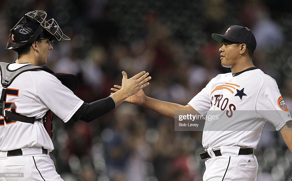 <a gi-track='captionPersonalityLinkClicked' href=/galleries/search?phrase=Wilton+Lopez&family=editorial&specificpeople=4901786 ng-click='$event.stopPropagation()'>Wilton Lopez</a> #59 of the Houston Astros shakes hands with catcher Jason Castro #15 after the final out against the Pittsburgh Pirates at Minute Maid Park on September 22, 2012 in Houston, Texas. Houston won 4-1.