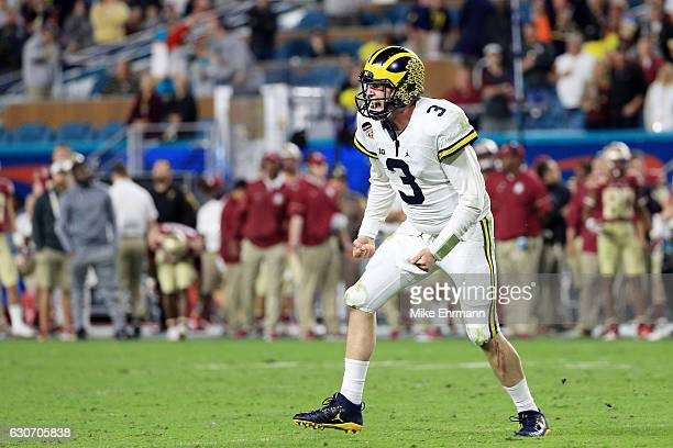Wilton Speight of the Michigan Wolverines reacts to a twopoint conversion in the fourth quarter against the Florida State Seminoles during the...