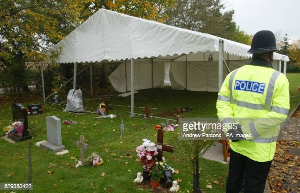 Wiltshire police officers stand guard in Mayshill Cemetery in Nibley Nr Yate in South Gloucestershire as a Marquee is put up The grave of a 44yearold...
