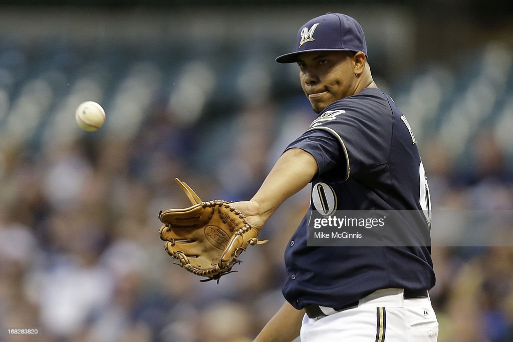 Wily Peralta #60 of the Milwaukee Brewers pitches in the top of the third inning against the Texas Ranger during the game at Miller Park on May 07, 2013 in Milwaukee, Wisconsin.