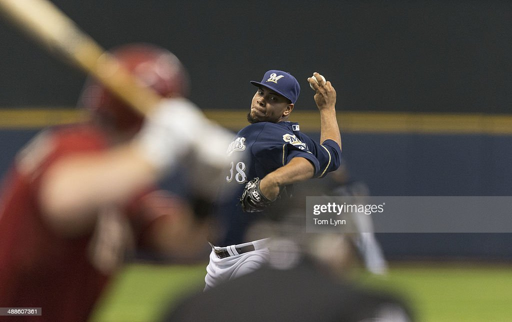 <a gi-track='captionPersonalityLinkClicked' href=/galleries/search?phrase=Wily+Peralta&family=editorial&specificpeople=7505871 ng-click='$event.stopPropagation()'>Wily Peralta</a> #38 of the Milwaukee Brewers pitches to <a gi-track='captionPersonalityLinkClicked' href=/galleries/search?phrase=Martin+Prado&family=editorial&specificpeople=620159 ng-click='$event.stopPropagation()'>Martin Prado</a> 14 of the Arizona Diamondbacks at Miller Park on May 7, 2014 in Milwaukee, Wisconsin.