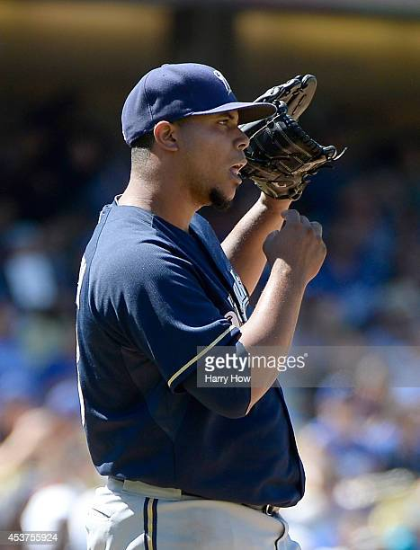 Wily Peralta of the Milwaukee Brewers reacts after a Yasiel Puig of the Los Angeles Dodgers single during the sixth inning at Dodger Stadium on...